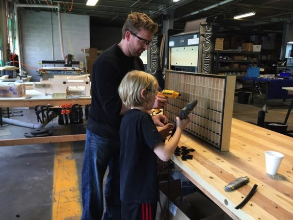 Lars-and-his-dad-building-the-cabinets-575x431